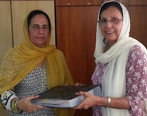 Gurtej Kaur (left) hands over to Satwant Kaur the duties as the head teacher of PEC PJ.
