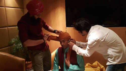 Saheb Singh tying a turban for Chandan Prabhakar who plays Raju in the Indian comedy sketch of Comedy Nights with Kapil. - PHOTO BY RISHIWANT
