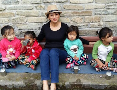 The writer with kids at the Tibetan school