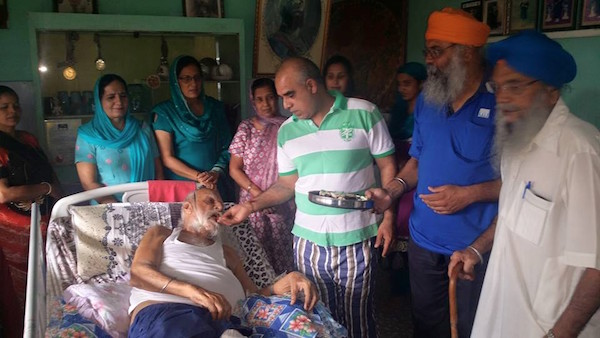 Jagjit Singh, former Tanjung Rambutan Gurdwara Sahib president, gets a visit form the Istri Satsang wing on Father's Day.