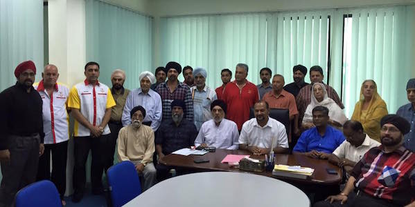 MP Gobind Singh (seated, fourth from left) and Selangor exco V Ganabatirau (seated, fifth from left) with representatives of Selangor gurdwaras at the cheque presentation ceremony on Aug 23.