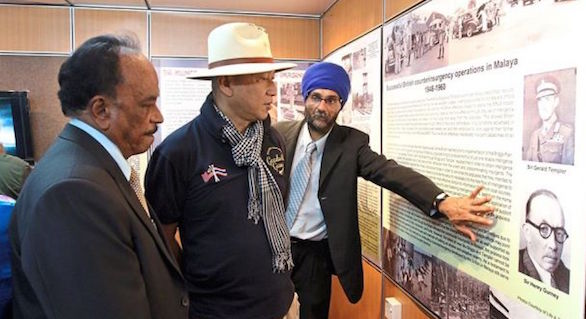 Harchand (right) explaining some of the details on the Malayan Emergency to Minister Nazri (centre) while Sivalingam looks on. - PHOTO STAR/MALAYSIA