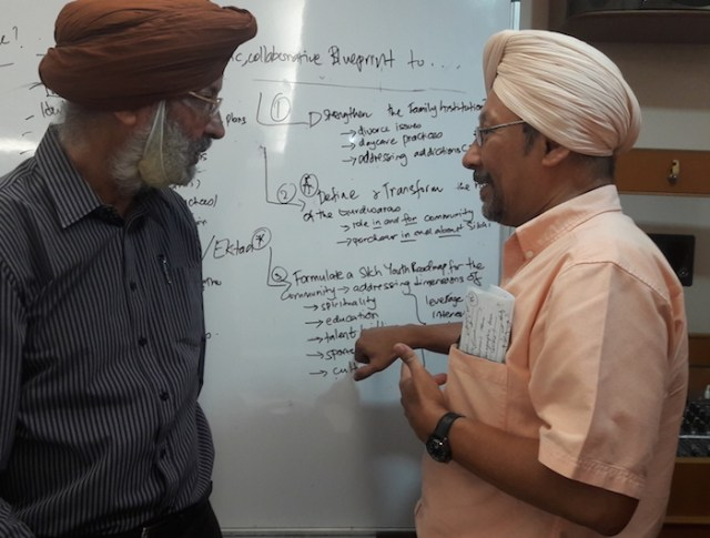 Senior civil servant Himmat Singh (right) in a post-forum chat with Khalsa Diwan Malaysia president Bagh Singh, who is the also CMSO chairman. - PHOTO ASIA SAMACHAR