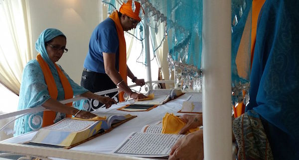 Ranjit Kaur and Harbindar Singh were among the volunteers at a three-day programme to manage the state of the copies of Sri Guru Granth Sahib kept at Gurdwara Sahib Pulapol, Kuala Lumpur. The seva ends on 1 Nov 2015. - PHOTO ASIA SAMACHAR/GURUJIT KAUR