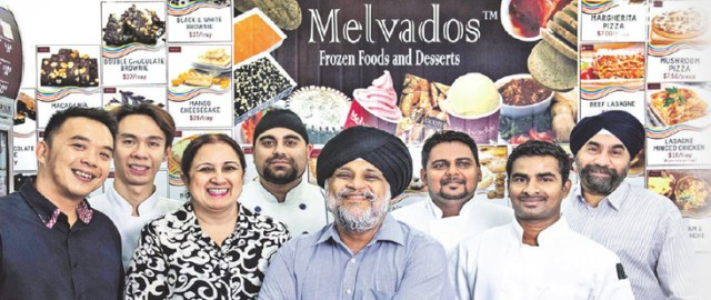Manmeet Singh and the team at Foodedge Gourmet, a Singapore-based food manufacturer. - PHOTO/ST