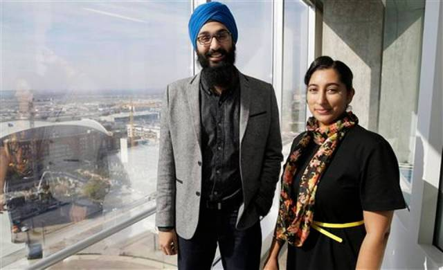 In this Dec. 11, 2015, photo, Darsh Singh, left, poses for a photo with his wife, Lakhpreet Kaur, in Dallas. It happens regularly: Someone sees a man with a turban and beard and hurls anti-Muslim slurs his way, or worse. Members of the Sikh religion, like Singh and his wife, also are feeling vulnerable as anti-Islamic sentiment heats up across the U.S., but instead of distancing themselves from Muslims, members of this southeast Asian religion are working with them to combat hateful rhetoric and dispel misconceptions about their respective faiths. LM Otero AP Photo BY TAMMY WEBBER / AP