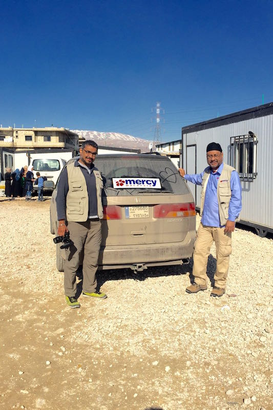 Against snow-capped mountains, Hardesh Singh (left) and Harmandar Singh aka Ham leading MERCY Malaysia's embedded media team in the Bekaa Valley, Lebanon.