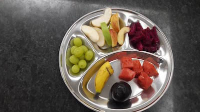 Fruits galore at Gurdwara Sahib Puchong as the Sanggat gathered for an evening programme to usher in 2016. They had prepared eight types of fruits. They also had cendol and air batu campur, two local delicacies. - PHOTO / ASIA SAMACHAR
