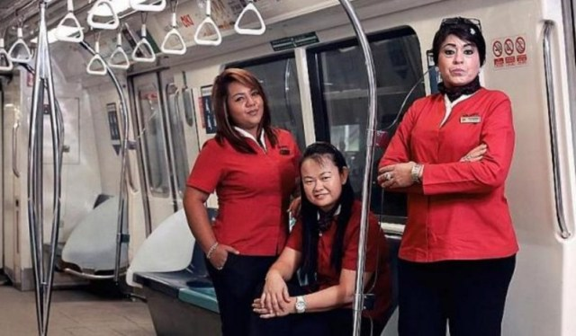 Sugvendar Kaur (right) with two other women train captains at Singapore's SMRT - PHOTO / TNP, PHYLLICIA WANG