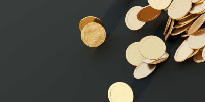 Microfinance - gold coins rolling down