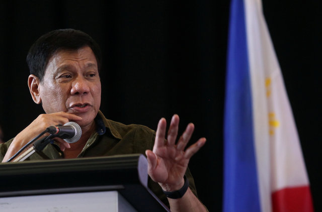 Philippine President-elect Rodrigo Duterte speaks during a conference with businessmen in Davao city, southern Philippines. Photo: Reuters/Lean Daval Jr