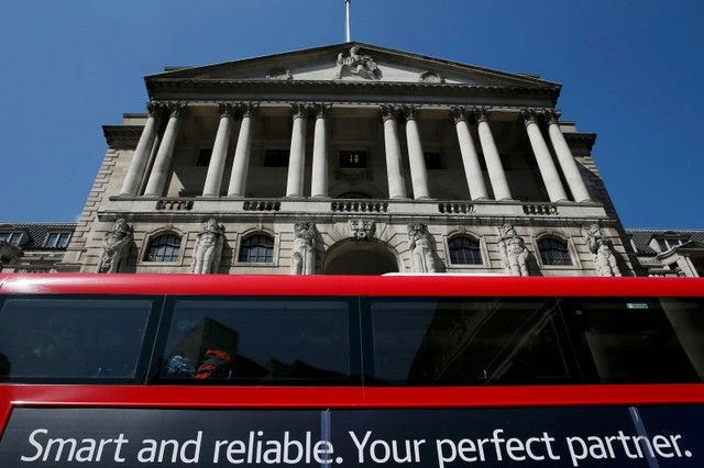 A bus passes the Bank of England in London in this file shot taken in May 2015.  Photo: Reuters