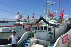 A Taiwanese fisherman is seen in his boat before setting sail to Itu Aba, Taiwan calls Taiping, in Pingtung, Taiwan
