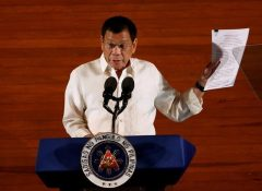 hilippine President Rodrigo Duterte holds up a copy of his speech as he speaks before the lawmakers during his first State of the Nation Address at the Philippine Congress in Quezon city, Metro Manila