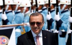 Turkish President Tayyip Erdogan reviews a guard of honour during a welcoming ceremony at the Presidential Palace in Ankara