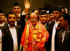 Nepal's newly elected Prime Minister Pushpa Kamal Dahal, also known as Prachanda, waves towards the media after he was elected Nepal's 24th prime minster in 26 years, in Kathmandu