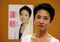 Japan's main opposition Democratic Party's lawmaker Renho poses in front of her poster during an interview with Reuters in Tokyo
