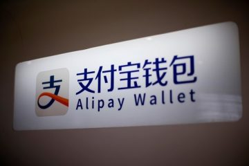 An Alipay logo is seen at a train station in Shanghai, China February 9, 2015. REUTERS/Aly Song