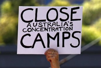 A protester holds a placard during a rally in support of refugees in central Sydney, Australia