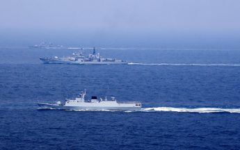 Chinese naval vessels participate in a drill on the East China Sea