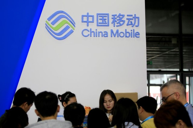 A sign of China Mobile is seen at CES (Consumer Electronics Show) Asia 2016 in Shanghai, China, May 12, 2016. Photo: Reuters/Aly Song