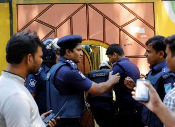 Security personnel enter a house after a gunbattle with militants on the outskirts of Dhaka