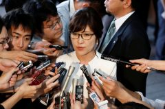 Japan's new defence minister Tomomi Inada talks to reporters at Prime Minister Shinzo Abe's official residence in Tokyo