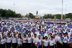 Thailand Election Commission's workers holds banners during an event to promote voting at the August 7 referendum on a new constitution in Bangkok