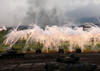 Japanese Ground Self-Defense Force tanks and other armoured vehicles take part in an annual training session near Mount Fuji at Higashifuji training field in Gotemba, west of Tokyo