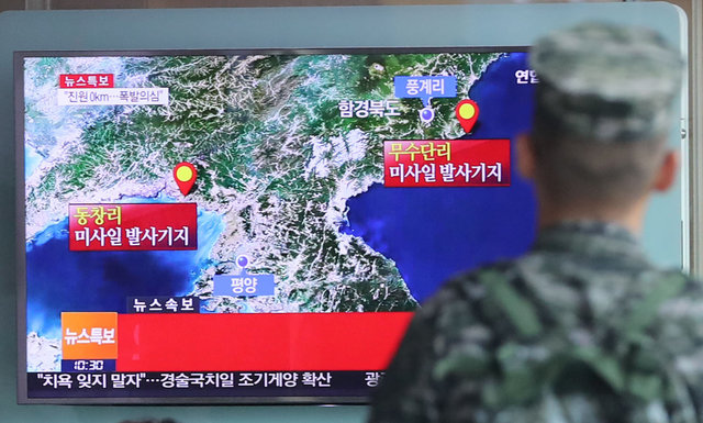 A South Korean soldier watches a TV news report on seismic activity produced by a suspected North Korean nuclear test. Photo: Yonhap via Reuters