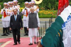 India's PM Modi reviews the guard of honour with his Vietnamese counterpart Phuc during a welcoming ceremony at the Presidential Palace in Hanoi, Vietnam