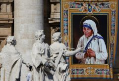 A tapestry depicting Mother Teresa of Calcutta is seen in the facade of Saint Peter's Basilica during a mass, celebrated by Pope Francis, for her canonisation in Saint Peter's Square at the Vatican