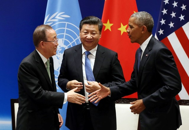 Chinese President Xi Jinping (C) shakes hands with US President Barack Obama and UN Secretary General Ban Ki-moon during a joint ratification of the Paris climate change agreement. Photo: Reuters, How Hwee Young