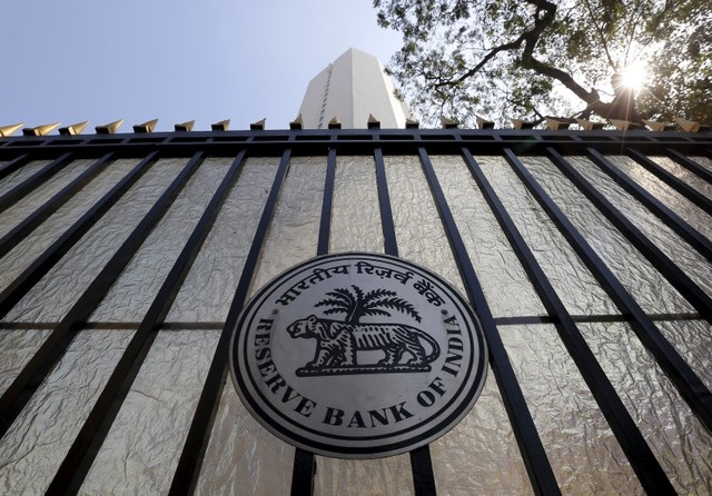 The Reserve Bank of India seal on a gate outside its headquarters in Mumbai.  Photo: Reuters/Danish Siddiqui