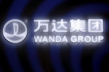 A sign of Dalian Wanda Group in China glows in Beijing, China March 21, 2016. Photo: Reuters/Damir Sagolj