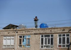 An Afghan policeman keeps watch near the site of a suicide attack in Kabul