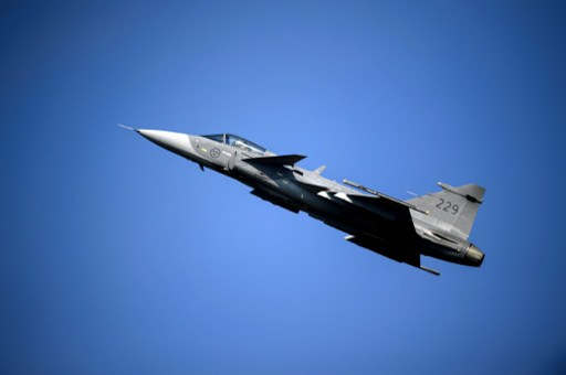 Swedish defense contractor Saab has been selling its fighter aircraft to countries such as junta-ruled Thailand, but could run up against a new 'democracy clause' in Swedish law. Photo: AFP / Fabrice Cofferini