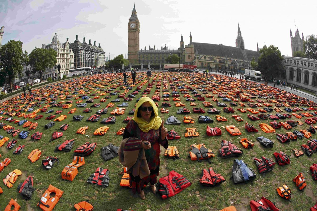 Rehab Sidiqi, a trustee of Woman for Refugee Woman and originally from Afghanistan, poses for a photograph among 2500 lifejackets worn by refugees during their crossing from Turkey to the Greek island of Chois, in Parliament Square in central London, Britain September 19, 2016. The display was organised by a number of charities and refugees to help focus attention of the UN summit on Addressing Large Movements of Refugees and Migrants.  REUTERS/Stefan Wermuth