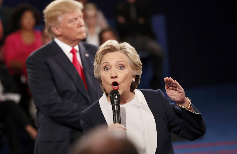 Democratic U.S. presidential nominee Hillary Clinton speaks during their presidential town hall debate with Republican U.S. presidential nominee Donald Trump at Washington University in St. Louis, Missouri, U.S., October 9, 2016. REUTERS/Rick Wilking