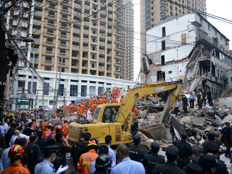 Rescue workers search at the site where residential buildings collapsed in Wenzhou, Zhejiang province, China, October 10, 2016. REUTERS/Stringer