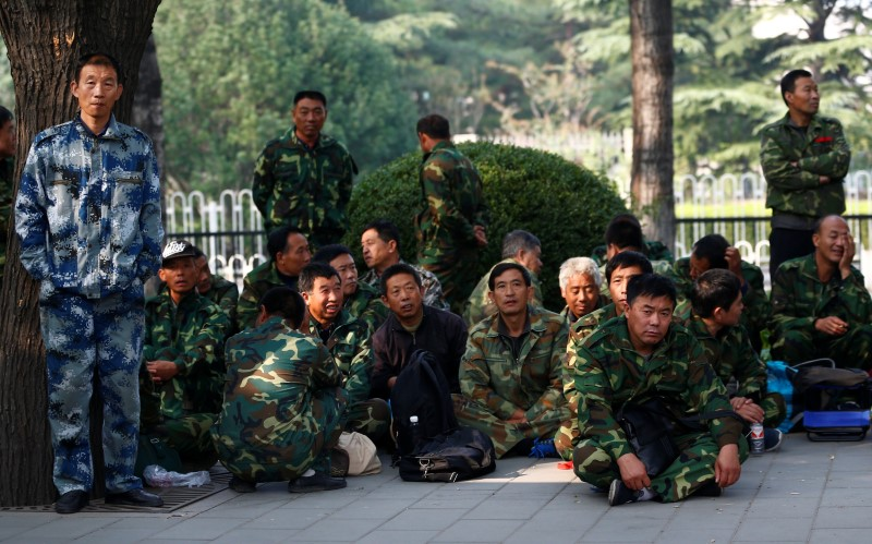 Uniformed people take part in a protest outside a major military building in Beijing, China, October 11, 2016. Photo: REUTERS/Thomas Peter
