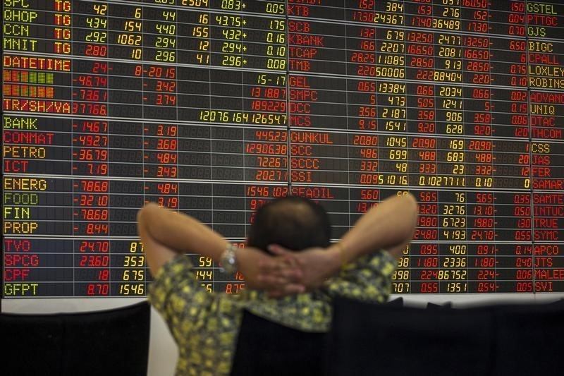 A Thai investor sits stock broker's office in central Bangkok. Asian emerging markets look to continue outperforming. Photo: Reuters, Athit Perawongmetha