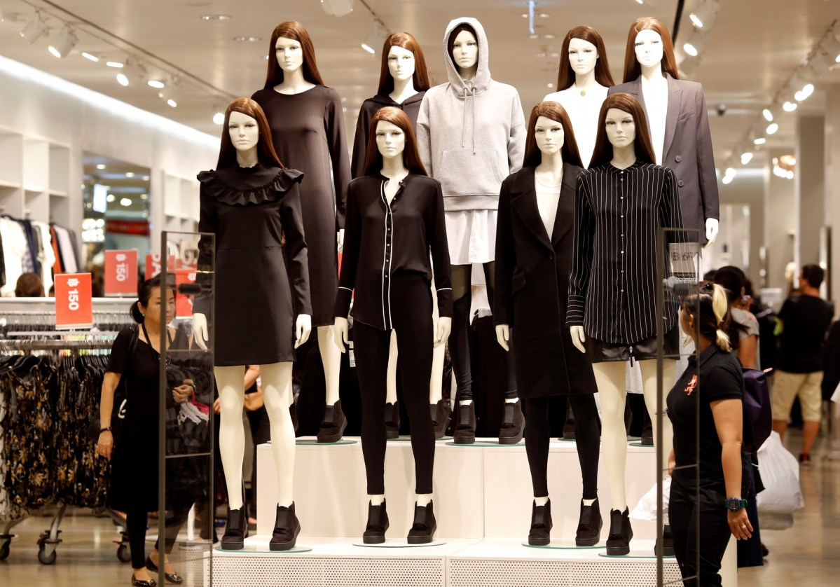 Mannequins are dressed in black and white as retailers pay their respects after the death of Thailand's late King Bhumibol Adulyadej, at a mall in Bangkok, October 15, 2016. Reuters