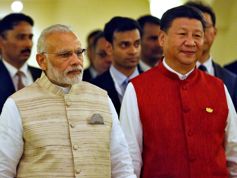 Indian Prime Minister Narendra Modi, left, and Chinese President Xi Jinping arrive for a photo ahead of the BRICS summit in Goa, India in October 2016. Photo: Reuters