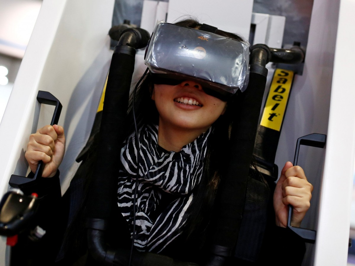 Is this the real life? Is this just fantasy? A woman sits in a VR Capsule, a virtual reality simulator, at the World Robot Conference 2016 in Beijing, China. The conference runs from October 21 to 25. Photo: Reuters/Thomas Peter