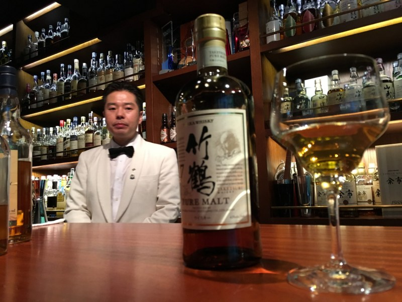 Mizunara: The Library's bartender-in-chief, Endo San, casts an eye over his favourite Asian tipple: the Nikka Taketsuru 17-year-old. Photo: Kenny Hodgart