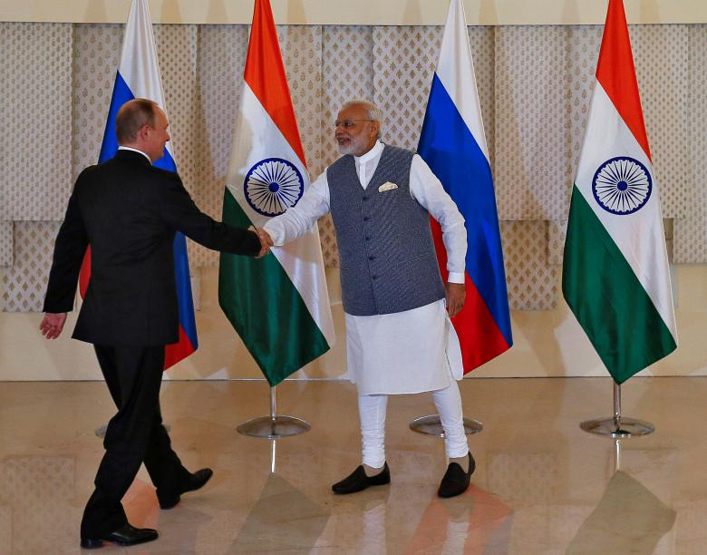 India's Prime Minister Narendra Modi (R) shakes hands with Russian President Vladimir Putin during a photo opportunity ahead of India-Russia Annual Summit in Benaulim, in the western state of Goa. REUTERS/Danish Siddiqui