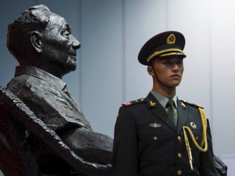 A People's Liberation Army soldier stands guard in front of a statue of the late Chinese leader Deng Xiaoping at an exhibition in Hong Kong commemorating the 110th anniversary of his birth in 2014. Photo: REUTERS