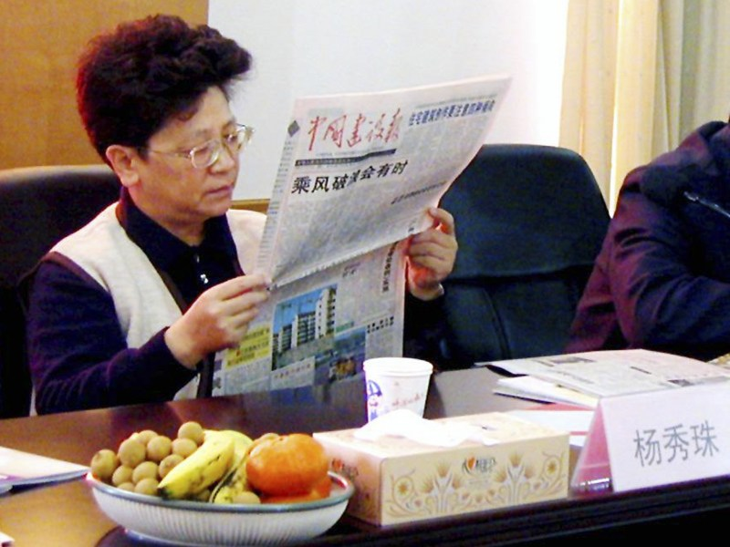 Yang Xiuzhu reading a newspaper during a meeting in Wenzhou, Zhejiang province. The former deputy mayor of Wenzhou had been in exile for the past 13 years in the US. Photo: Reuters