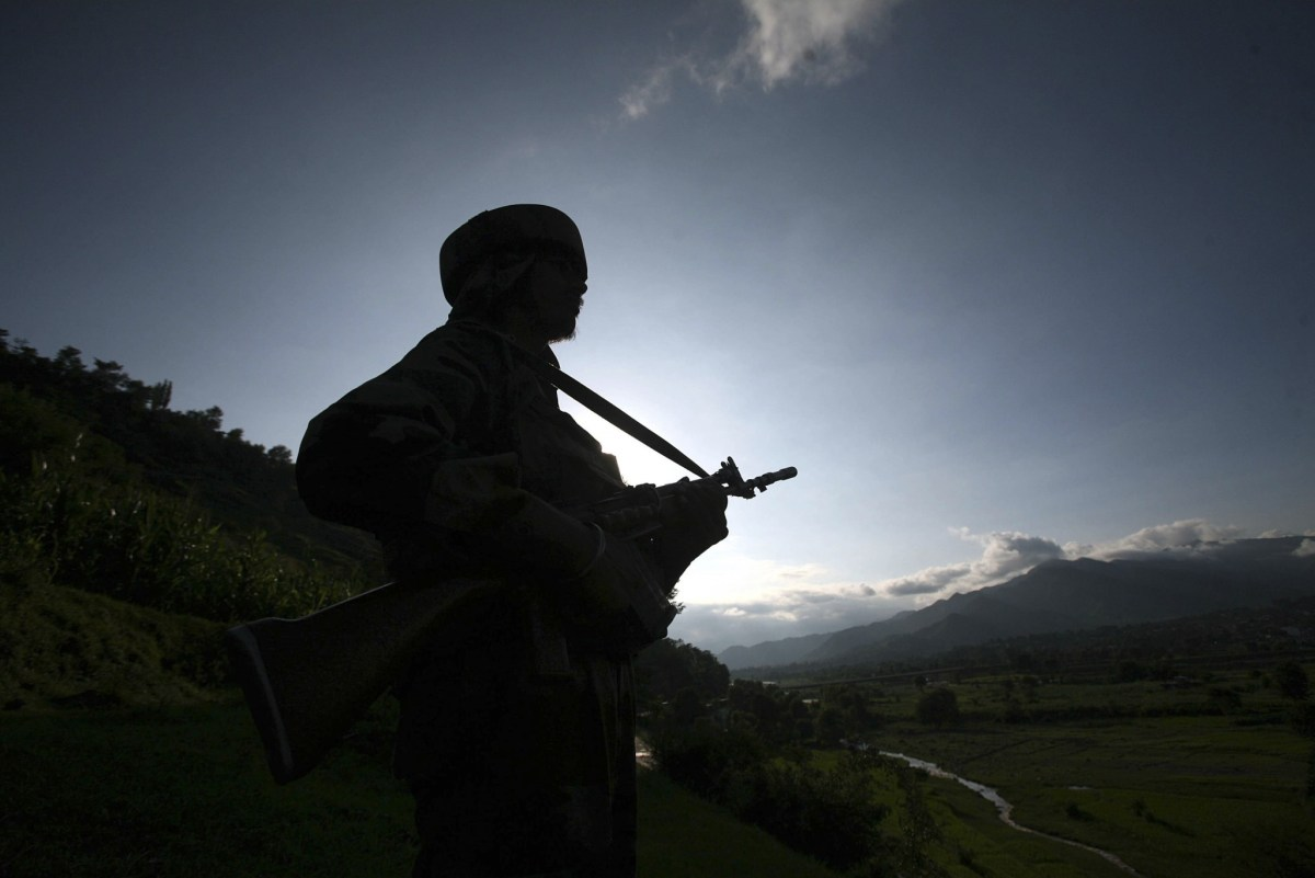 An Indian soldier stands guard near the Line of Control in Kashmir. Photo: Reuters/Mukesh Gupta